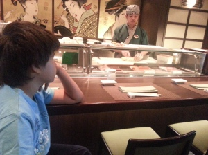 Our son learning to do the sushi