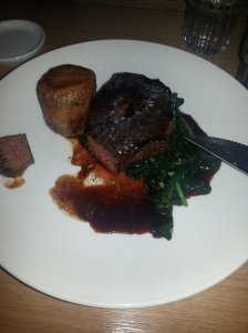 Aged beef fillet with fondant potato, spinach and truffles